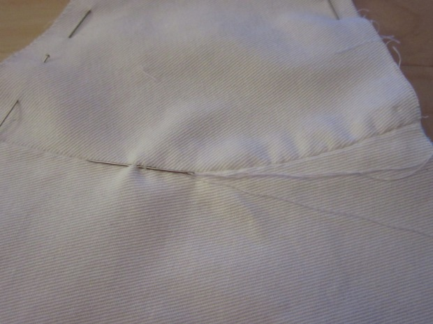 Joining the layers by stitching through the side seams.